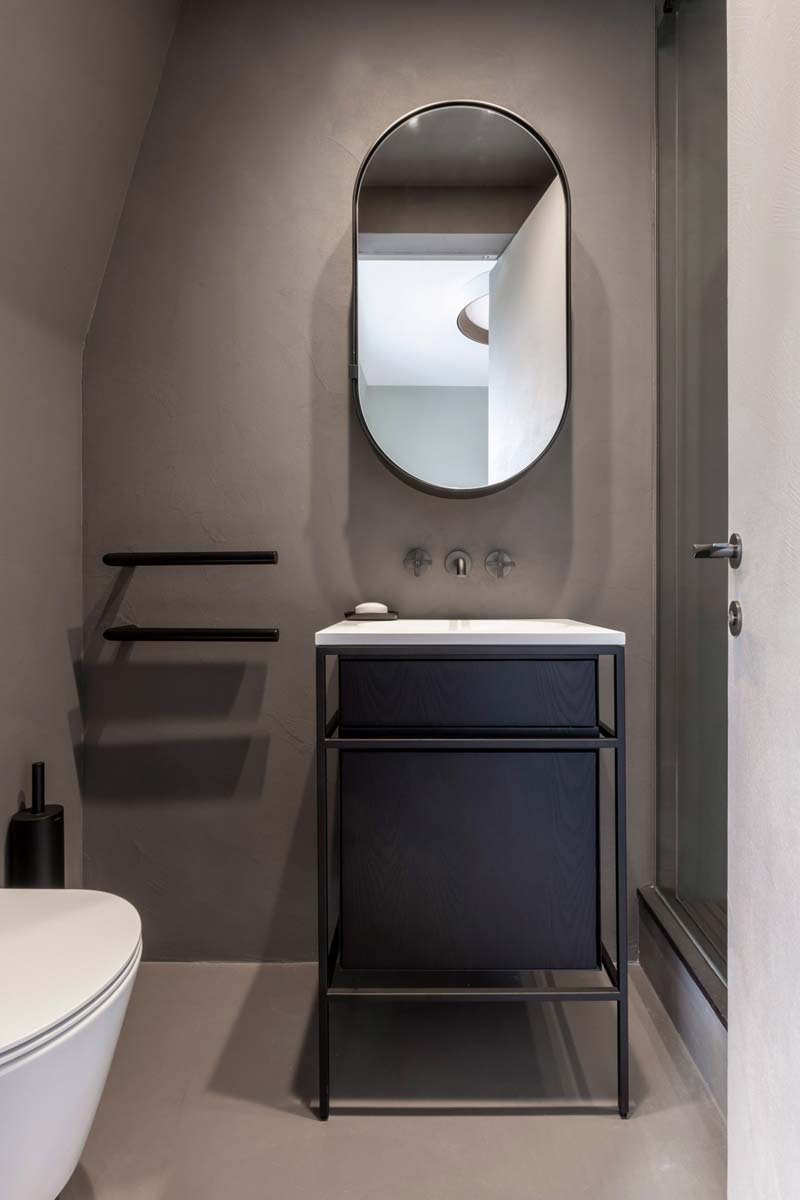 kleine badkamer betonlook muren vloer