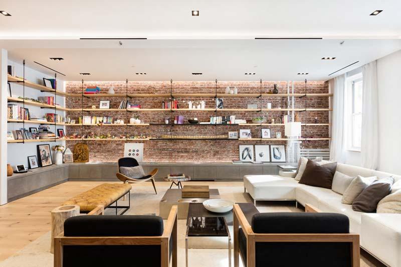 woonkamer maatwerk betonlook tv meubel wandplanken bakstenen muur